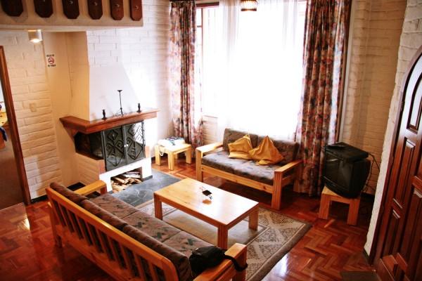 Sala de estar con chimenea. Apartamento para 6 personas.